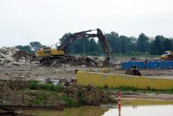 Excavators tear up concrete, rebar, and asphalt at the old Chrysler stamping plant (pic: Brian Bull)