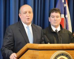 FBI Special Agent in Charge Stephen Anthony talks to reporters as Cuyahoga County Sheriff Frank Bova looks on.