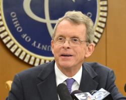 Attorney General Mike DeWine speaks at a May 2014 press conference. (Nick Castele / ideastream)