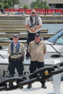 Sheriff's deputies with their patrol boat (pic: Brian Bull)