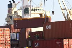 Cargo containers being unloaded (pic: Brian Bull)