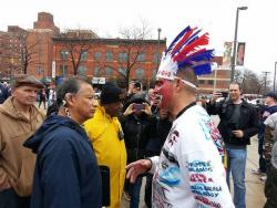 Local American Indian activist and education advocate Robert Roche and a red-faced Tribe fan (pic: Peter Pattakos)