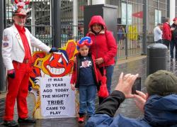 A mother and son pose before a Chief Wahoo sign at the Indians' season opener this year (pic: Brian Bull)