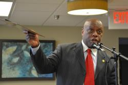 East Cleveland Councilman Nathaniel Martin talks about the city's challenges at a meeting in April. (Nick Castele)