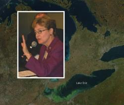 Rep. Marcy Kaptur with satellite map of Lake Erie with algae growth (Brian Bull/NASA Goddard Space Flight Ctr)