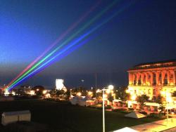 "The ""Global Rainbow"" streaks across the sky over downtown Cleveland (PHOTO: Mike Shafarenko)"