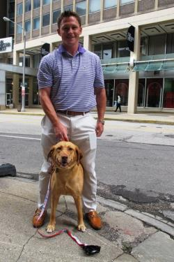 Brent Zimmerman, area businessman and resident, with his dog, Lily (pic by Brian Bull).