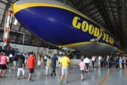 More than 2000 people showed to watch the new blimp be christened Wingfoot One.