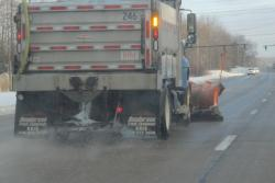 A truck salts the roads in Solon last winter. (Brian Bull / ideastream)