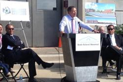 Gov. John Kasich speaks next to Columbus Mayor Michael Coleman, left. (Andy Chow / Ohio Public Radio)