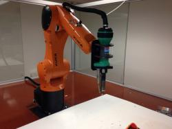 Peters modified a 3D printer so a large robot arm can extrude plastic or ceramic to make building blocks.