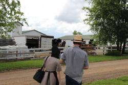 A young Amish couple walks their baby back to their buggy after receiving a measles vaccine.