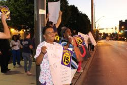 Workers line St. Claire Avenue in Cleveland during the morning commute to raise awareness for wage increases.