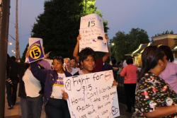 "Home care workers march in front of a McDonalds during the early morning commute in Cleveland. ""We want change and we don't mean pennies."""
