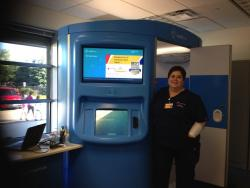 Medical technician Heather Roberts stands outside the HealthSpot kiosk in Cleveland's Central Promise neighbhorhood.