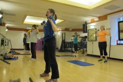 Employees participate in a fitness class at Sherwin Williams.