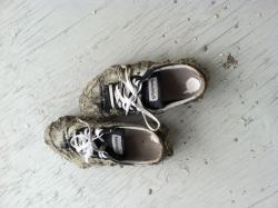 The reporter's shoes after trekking through the muddy vacant lot where a rain garden is being installed.
