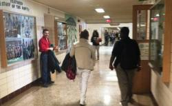Students and staff walk the hallways at Bedford High School.