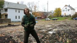 Cleveland Botanical Garden Researcher Sandra Albro plants a rain garden in a vacant lot in Slavic Village.