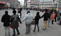 Demonstrators protest the decision not to indict police officers in the fatal shooting of Tamir Rice.