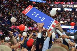 Ohio delegates remove their sign from its pole at the Republican National Convention.