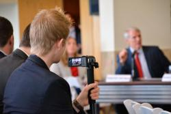 A tracker videotapes Sen. Rob Portman at an event in March.
