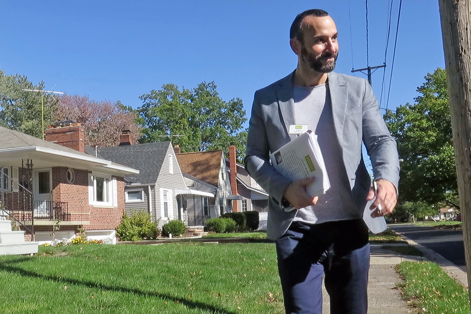 """Competition is good,"" says realtor Jim Haffey, as goes door-to-door in Rocky River, handing up information on recent home sales and hoping to find potential clients. ""It's making me step my game up."""