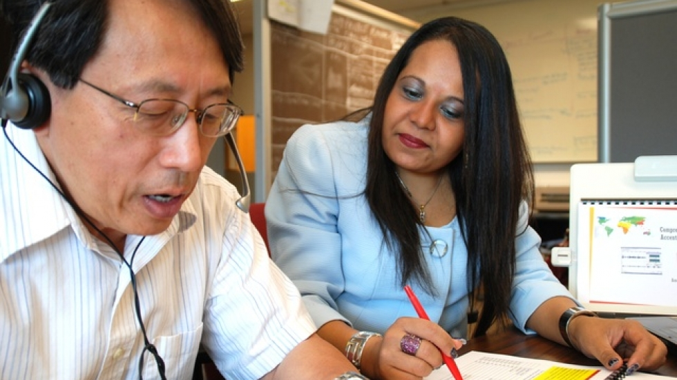CSU's Amee Shah checks the accent of Engineering prof Paul Lin