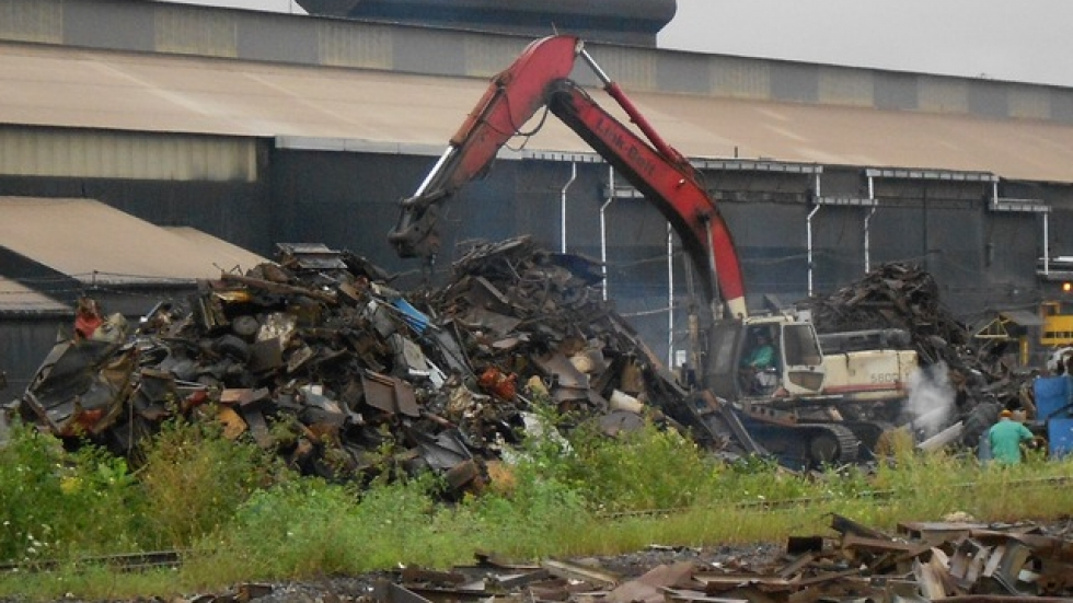 A pile of scrap metal is sorted by an industrial shovel in Youngstown, for a local plant (photo by Brian Bull)