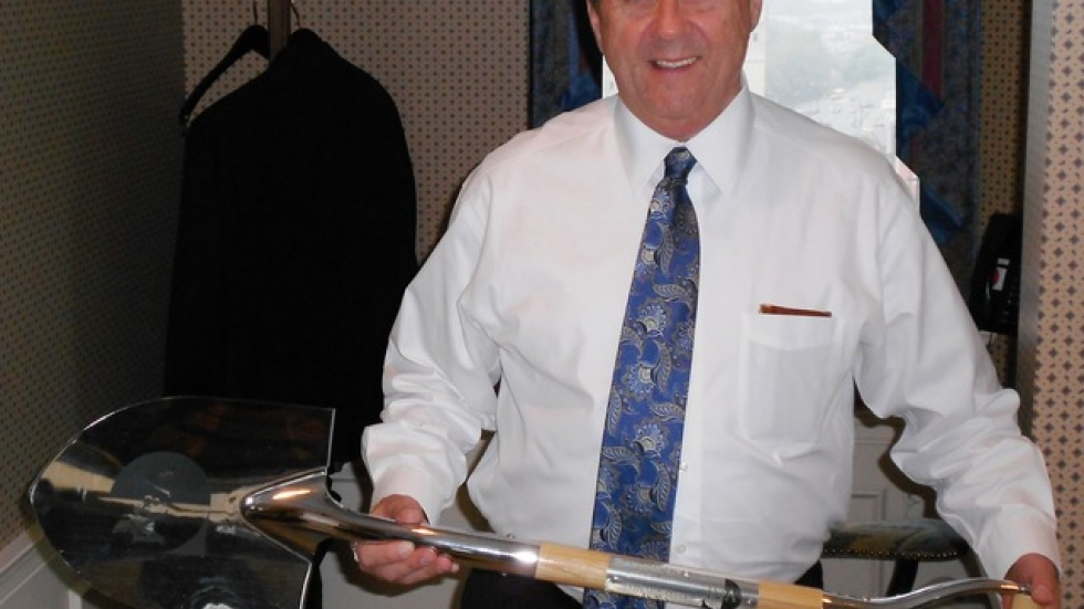 Thomas Humphries of the Warren-Youngstown Regional Chamber of Commerce, holds a shovel from the V&M Star groundbreaking.