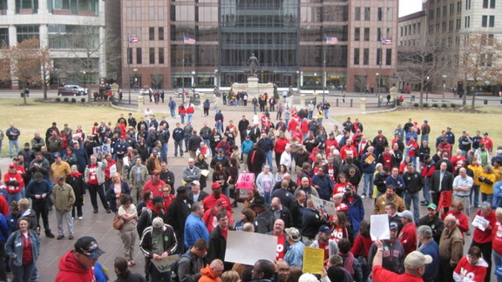 Crowd gathers outside the Statehouse.