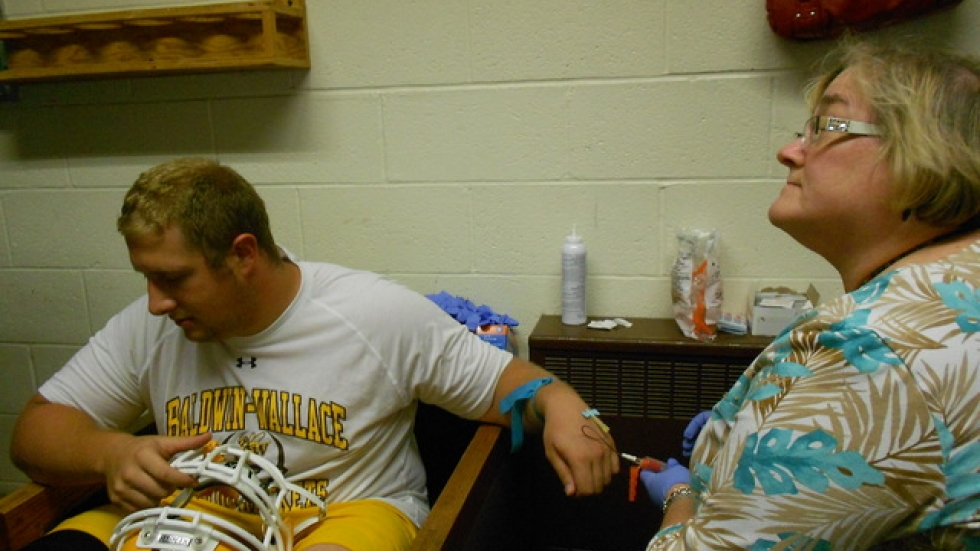 Baldwin Wallace Center Kyle Augustitus gets his blood drawn as part of the Clinic concussion study.