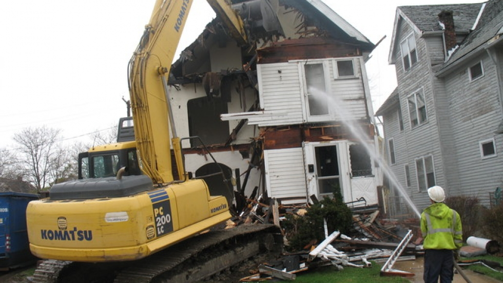 Cuyahoga Land Bank workers demolish a foreclosed Cleveland home (pic by Brian Bull).