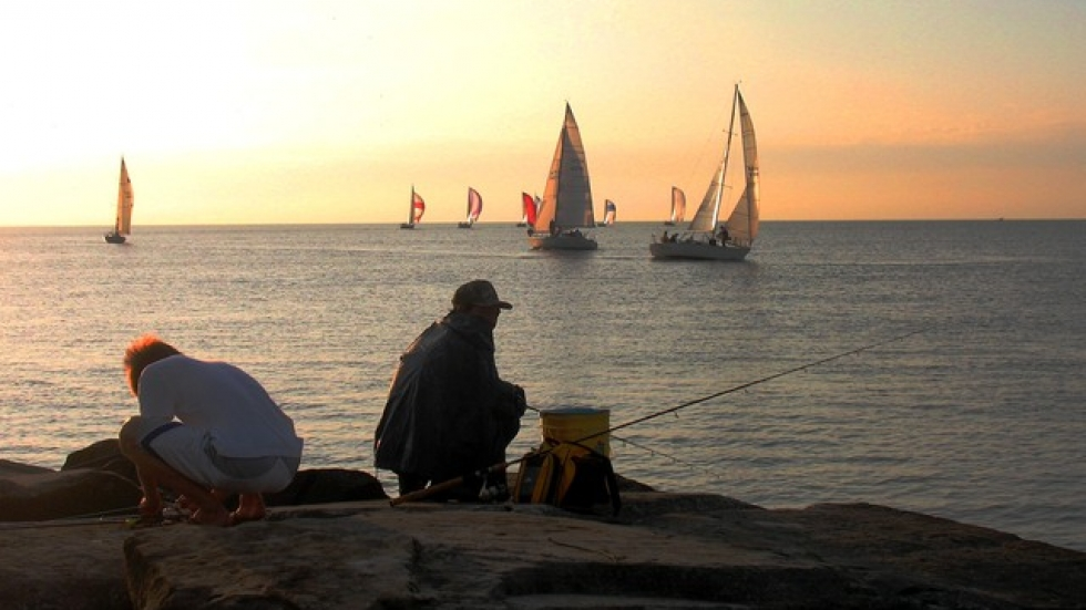 Anglers and sailboat enthusiasts enjoy Lake Erie outside Edgewater Park (pic by Brian Bull).