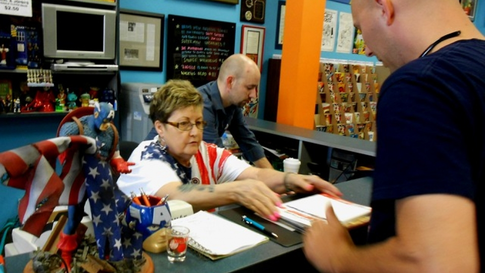 Counter staff at John and Carol's Comic Book Shop tackle hundreds of superhero enthusiasts (pic by Brian Bull)