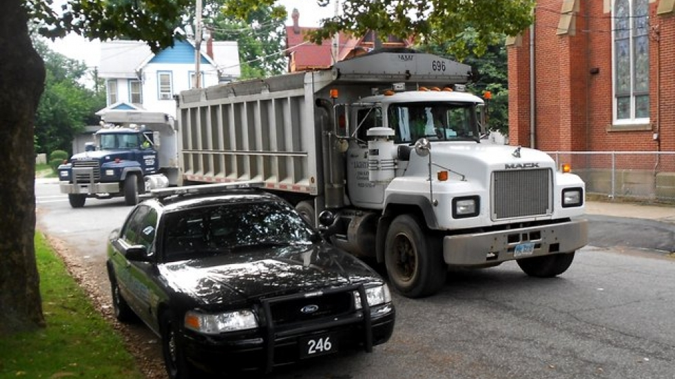 Trucks arrived after a couple of hours to haul away the rubble (pic by Brian Bull)