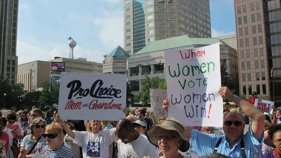 Abortion rights activists demonstrate in Columbus this year.