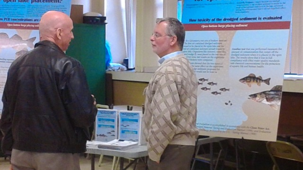Scott Pickard, an Army Corps of Engineers ecologist, speaks with members of the public at the open house on dredging.