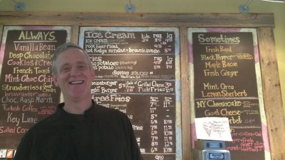 Keith Logan, owner of Sweetie Fry, likes the idea of an alternative payment system. (Tony Ganzer/WCPN)