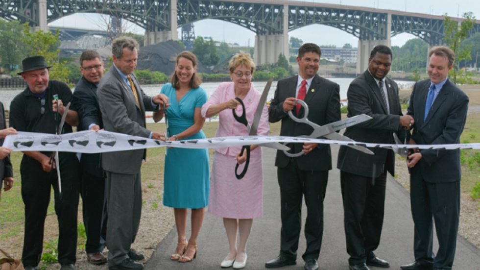 Elected officials and others cut the ribbon to mark the park's opening.
