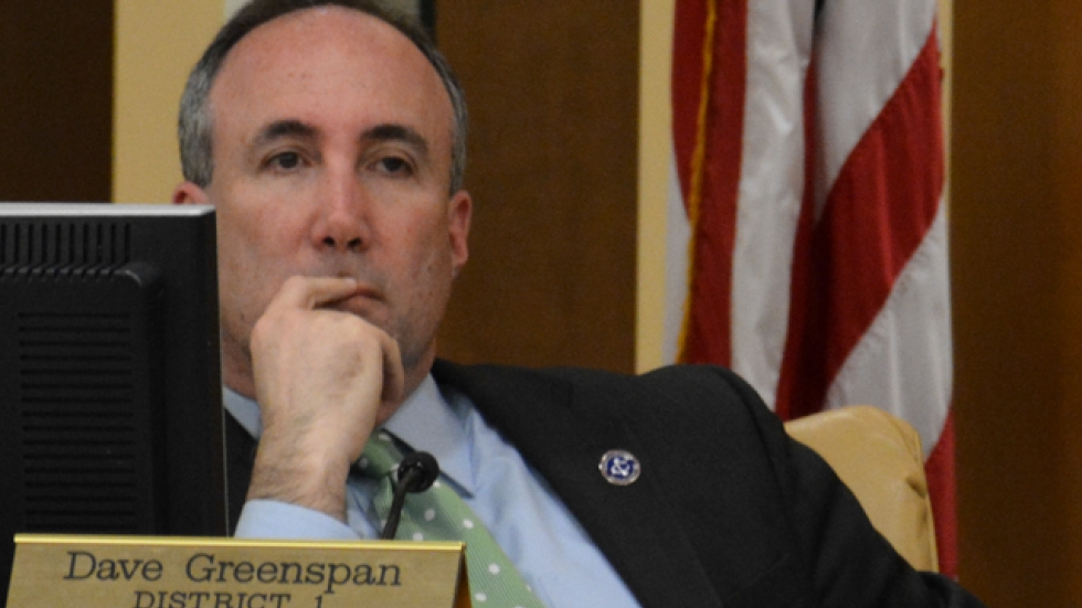 Cuyahoga County Councilman Dave Greenspan listens at a council meeting earlier this year.