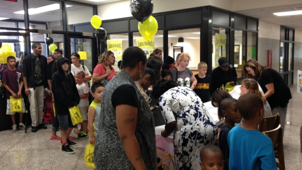 Families and students stroll in to Hartford Middle School's open house.