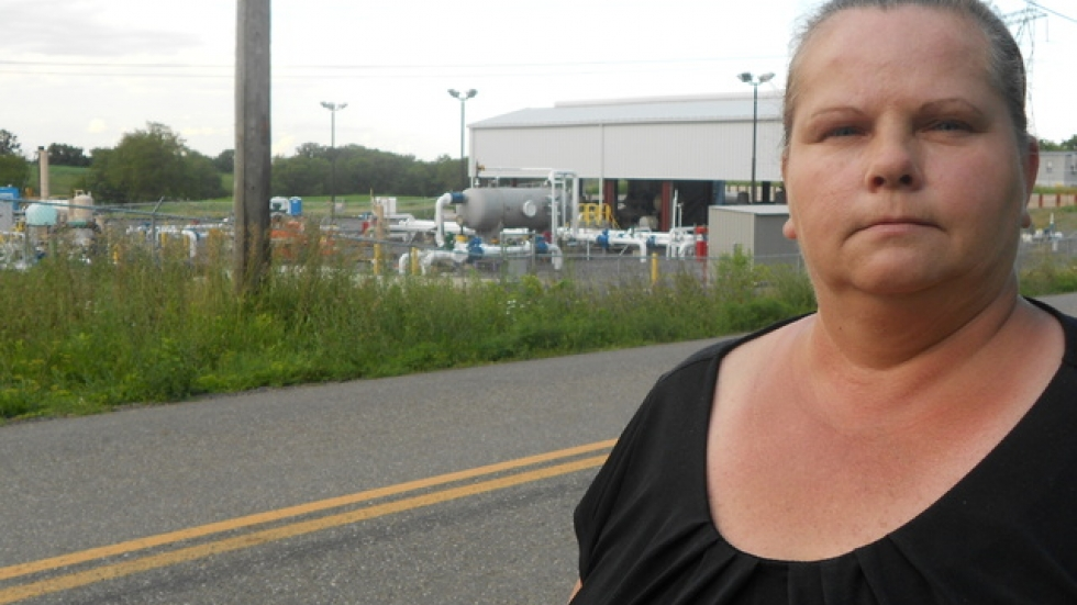 Theresa Brothers, in front of the natural gas compressor station the Brothers say will likely force them to move.