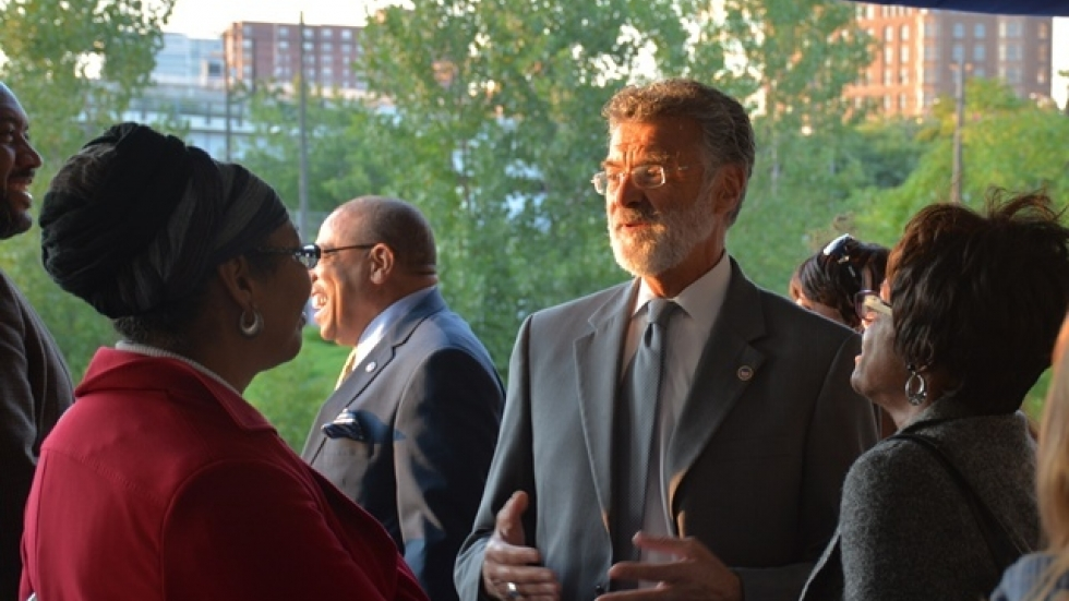 Cleveland Mayor Frank Jackson talks with guests on the Goodtime III. (Nick Castele / ideastream)