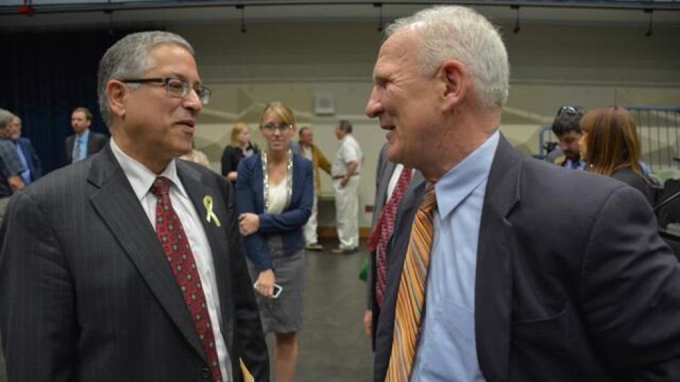 Armond Budish and Jack Schron speak after a candidate forum earlier this year.