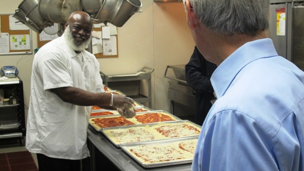 Sen. Portman talks to cooks preparing pizza at The City Mission (pic: Brian Bull)