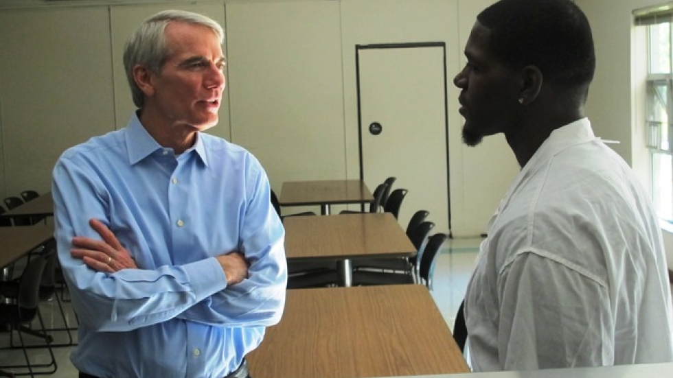 Sen. Portman talks to a kitchen worker at The City Mission (pic: Brian Bull)