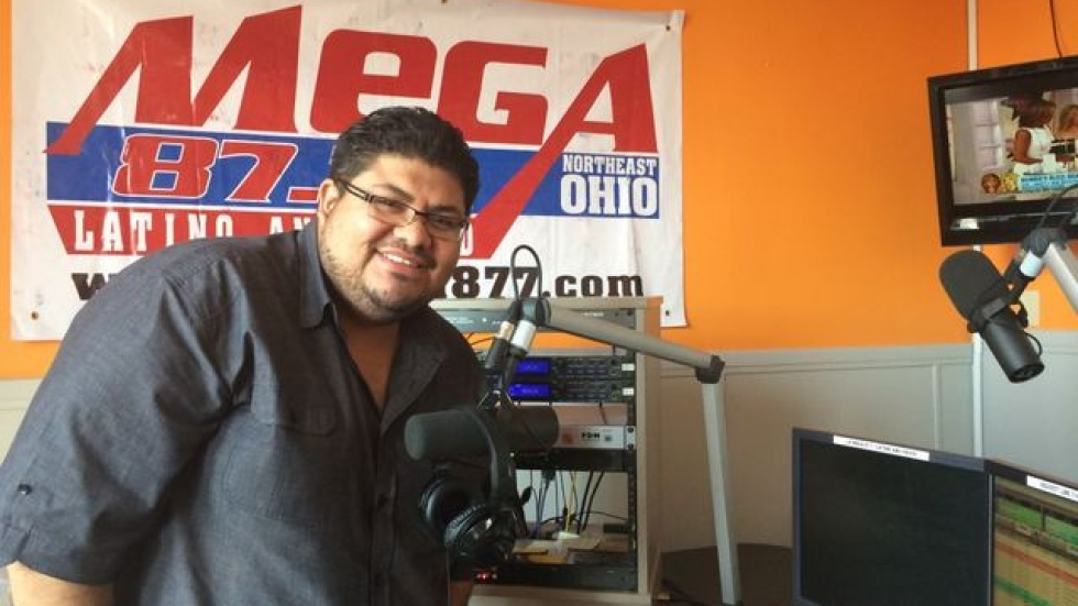 Program director Daniel Melendez in La Mega's studio. (Tony Ganzer/WCPN)
