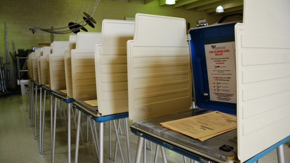 Voting booths line the floor of a school gym in Cleveland's Central neighborhood. (Nick Castele / ideastream)