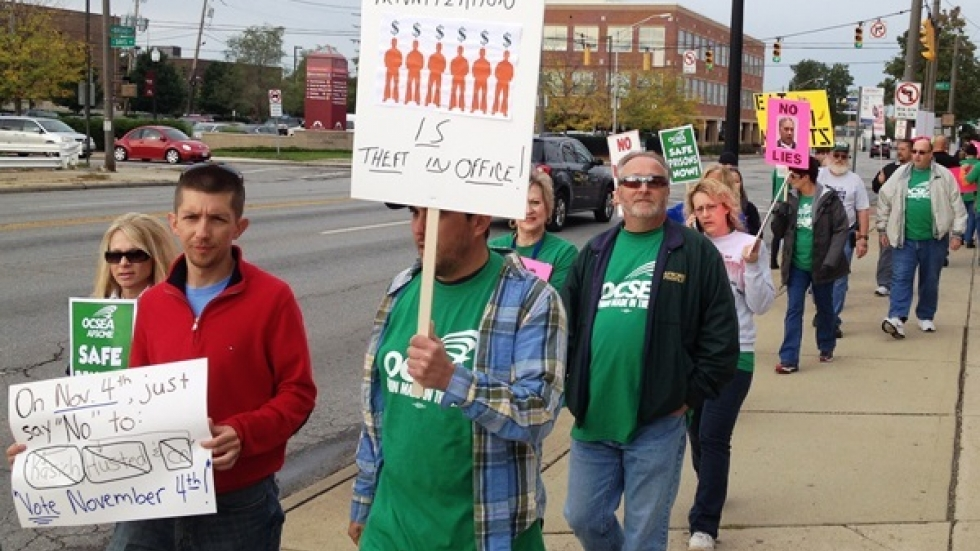 Ohio's prison employee's union protests outside the department headquarters. (Andy Chow / Ohio Public Radio)